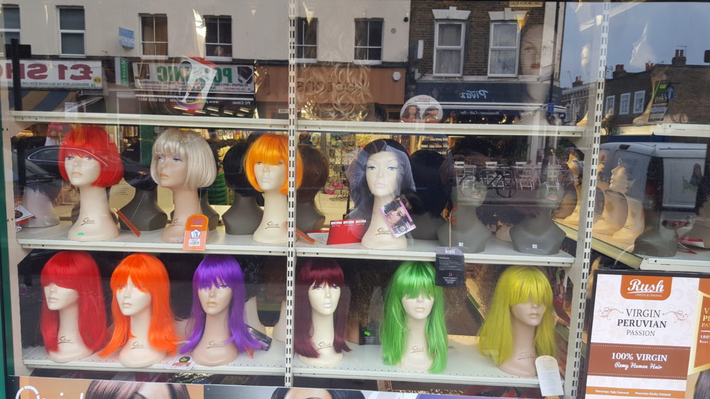 Wigs in a window